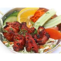 Sliced chicken in spicy marinade, cooked in Tandoor. Served with vegetables