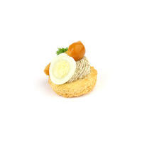 3553. Mushroom mousse with quail egg and truffle oil on toast
