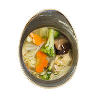 Chicken soup with rice noodles, egg and Shiitake mushrooms