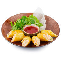 Crispy rolls stuffed with shrimps and cheese