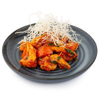 Piquant tiger prawns in tomato-basil sauce with chili