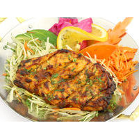 Salmon steak marinated with basil, cooked in tandoor, with fresh vegetables