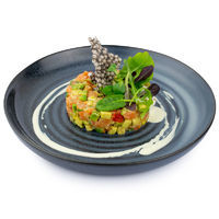 Salmon tartar with avocado, tomatoes, fresh ginger with wasabi sauce