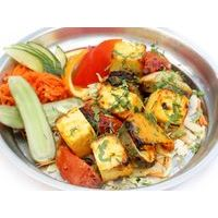 Tandoor baked homemade piquant cheese with vegetables