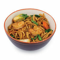 Udon noodles with Pak Choi cabbage, mushrooms and tiger prawns in japanese Yakisoba sauce